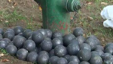 Video shows metal balls rolling down Seattle street, hitting cars